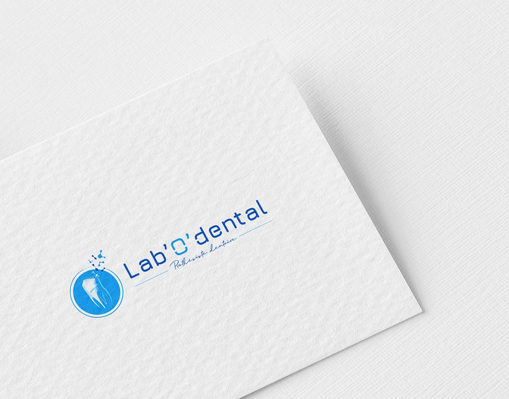 logo rond bleu dentiste graphiste